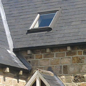 Velux window in slate roof